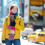 Beautiful young woman sightseeing at Times Square, New York Royalty Free Stock Image