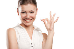 Beautiful young woman signaling ok. Isolated over white background royalty free stock photography