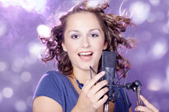 Beautiful young woman sing Stock Photos