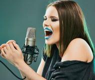 Beautiful young woman singer. Emotional teen girl. Music model stock photos