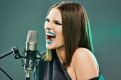 Beautiful young woman singer. Emotional teen girl. Music model royalty free stock photo