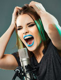 Beautiful young woman singer Royalty Free Stock Photography
