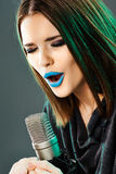 Beautiful young woman singer. Emotional teen girl Royalty Free Stock Photo