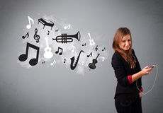 Beautiful young woman singing and listening to music with musica Stock Photo