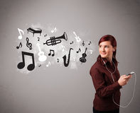 Beautiful young woman singing and listening to music with musica. L notes and instruments getting out of her mouth Royalty Free Stock Images