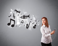 Beautiful young woman singing and listening to music with musica. L notes and instruments getting out of her mouth Royalty Free Stock Photography
