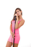 Beautiful young woman singing on microphone Stock Photos