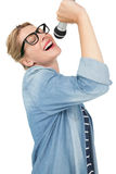 Beautiful young woman singing into a microphone Royalty Free Stock Image
