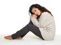 Beautiful young woman sit on floor, white background Royalty Free Stock Photos