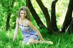 Beautiful young woman sitting on Stock Photo