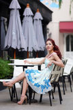 Beautiful young woman sitting alone in street cafe Royalty Free Stock Image