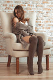 Beautiful Young Woman Sitting In Armchair Royalty Free Stock Image