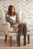 Beautiful Young Woman Sitting In Armchair Royalty Free Stock Photos
