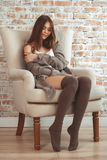 Beautiful Young Woman Sitting In Armchair Royalty Free Stock Photography