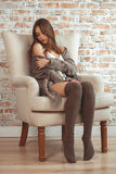 Beautiful Young Woman Sitting In Armchair Stock Photo