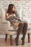 Beautiful Young Woman Sitting In Armchair Royalty Free Stock Photo