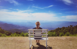 Beautiful young woman  sitting on a bench at Doi Inthanon  National Park Stock Photo