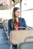 Beautiful young woman sitting in bus Royalty Free Stock Photography