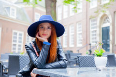 beautiful young woman sitting in the cafe Royalty Free Stock Photo