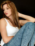 Beautiful Young Woman Sitting in a Chair with thoughtful Expression Royalty Free Stock Photos