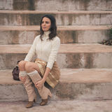 Beautiful young woman sitting on concrete steps Royalty Free Stock Photography