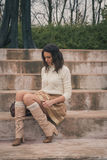 Beautiful young woman sitting on concrete steps Stock Image