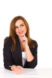 Beautiful young woman sitting at the desk and thinking. Royalty Free Stock Images