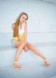 Beautiful young woman sitting. Royalty Free Stock Image