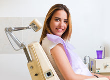 Beautiful young woman sitting in an examination chair Stock Photos