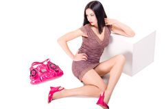Beautiful young woman sitting on the floor Stock Photography