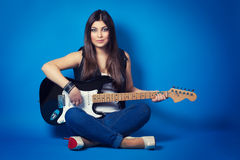 Beautiful young woman sitting with guitar Royalty Free Stock Photography