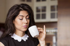 Beautiful young woman sitting at home ,drinking  coffee Royalty Free Stock Photography