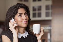 Beautiful young woman sitting at home ,drinking coffee royalty free stock image