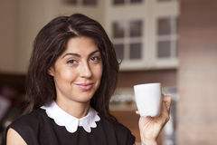 Beautiful young woman sitting at home ,drinking coffee stock photography