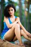 Beautiful Young Woman sitting on log posing Royalty Free Stock Photos