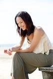 Beautiful young woman sitting outdoors Stock Photo