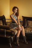 Beautiful young woman sitting in a shoes Stock Photos
