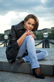 Beautiful young woman sitting on steps Stock Photography