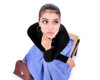 Beautiful young woman sitting with trendy bag Royalty Free Stock Photos
