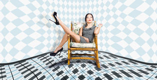 Beautiful young woman sitting in a trendy shoes Royalty Free Stock Photography
