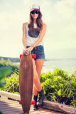 Beautiful young woman with a skateboard Royalty Free Stock Photo
