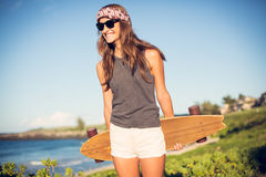 Beautiful young woman with a skateboard Stock Photo