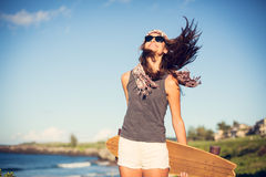 Beautiful young woman with a skateboard Royalty Free Stock Image