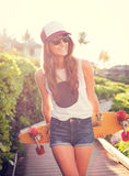 Beautiful young woman with a skateboard Stock Images