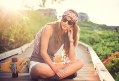 Beautiful young woman with a skateboard Royalty Free Stock Images