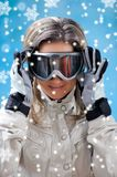 Beautiful young woman in ski clothes Stock Photography