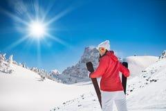 Beautiful young woman with ski. Stock Photos
