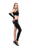 Beautiful young woman in skintight black costume. Isolated Stock Photography