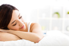 Beautiful young  woman  sleep on the bed Stock Photos