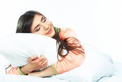 Beautiful young woman sleep in bed. Stock Photography